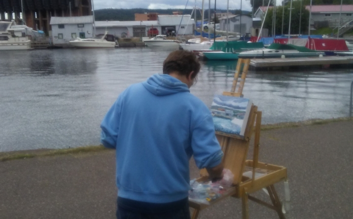en plein air painting outside at Marquette's lower harbor
